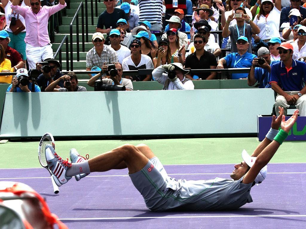 Djokovic si aggiudica il punto decisivo, Miami 2014 (foto ART SEITZ)