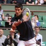 ROLAND GARROS 3JUNE214 NOVAK DJOKOVIC. ROLAND GARROS TENNISBALL ON STRINGS