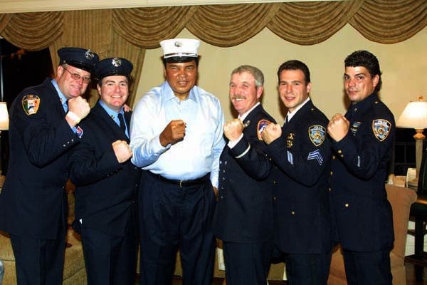 Delray Beach, Florida  2001/10/25  Muhammad Ali with members of the NYPD and NYFD at Bob Beamon Golf & Tennis Classic.  Photo by Art Seitz